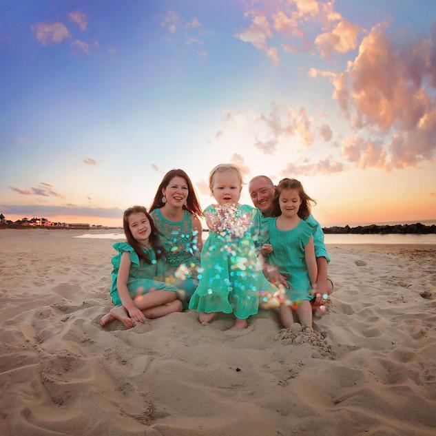 pretty family on beach