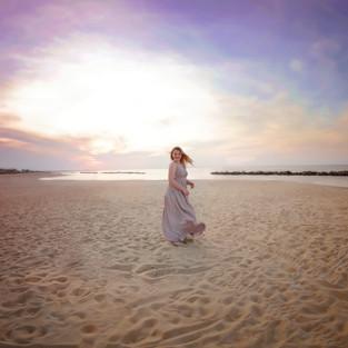 girl dancing on the beach