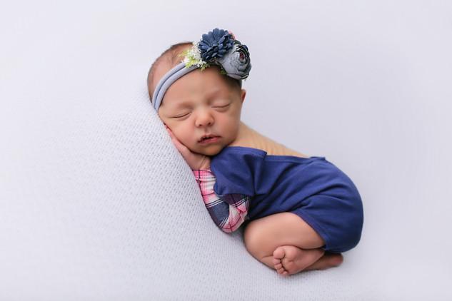 Newbeon girl wearing blu, asleep