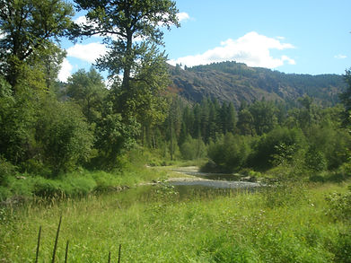The Sanpoil River runs from its headwaters in the Kettle Range south to  Lake Roosevelt.