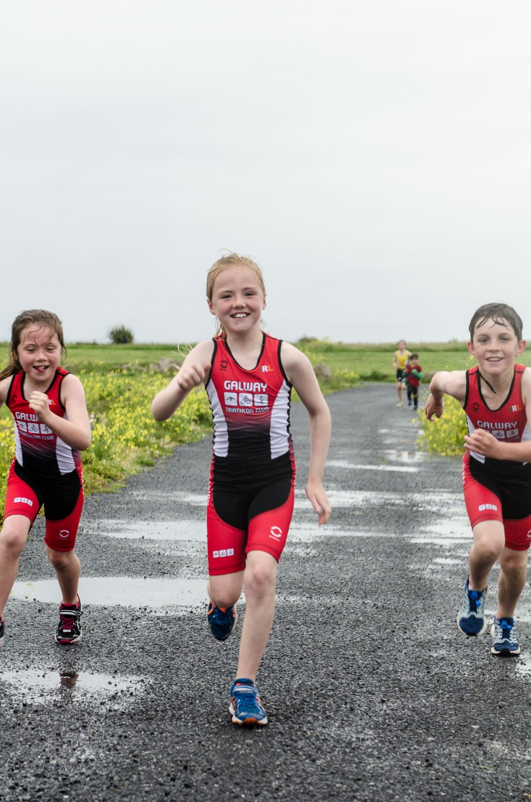 Heather Loomes, Caoimhe Loomes and Dylan Cassidy testing their new triathlon gea