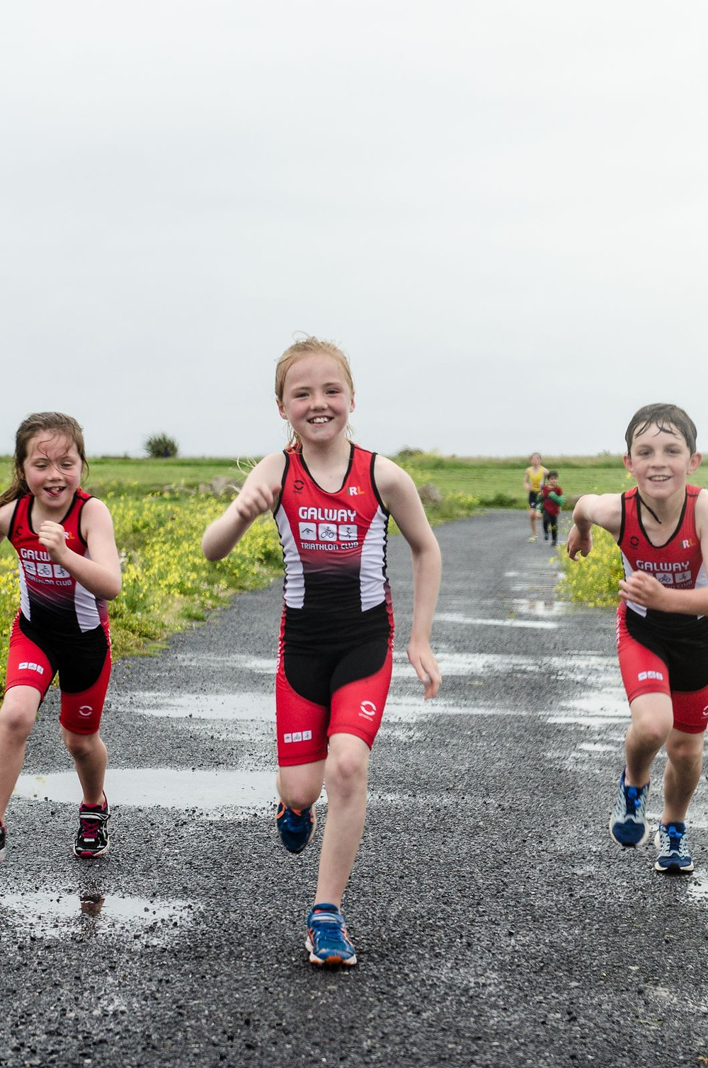 Heather Loomes, Caoimhe Loomes and Dylan Cassidy testing their new triathlon gear at the launch of the GTC Junior Section last night Photo Credit Michal Dzikowski.jpg
