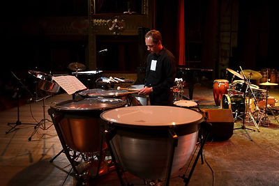 Greg Haynes playing music on steel pan