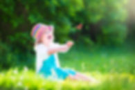 Toddler Girl Playing With Butterfly.jpg