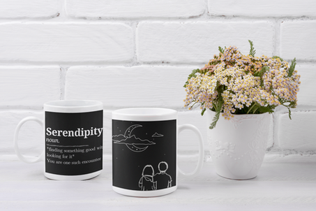 mockup-of-two-coffee-mugs-placed-next-to-some-flowers-43570-r-el2.png