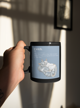sticker-mockup-featuring-a-man-holding-a-coffee-mug-33617.png