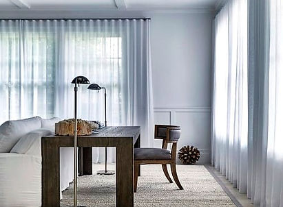 Ripple fold curtains in lounge room