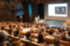 067442881-business-speaker-giving-talk-c