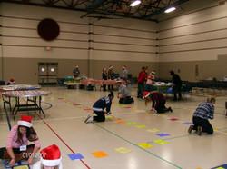 volunteers set up cake walk 12212014