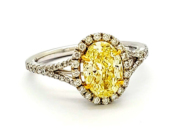 FANCY OVAL YELLOW DIAMOND RING