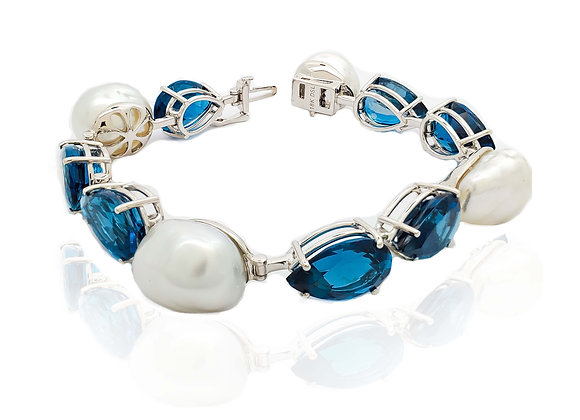 PEAR SHAPE TOPAZ AND SOUTH SEA PEARL BRACELET