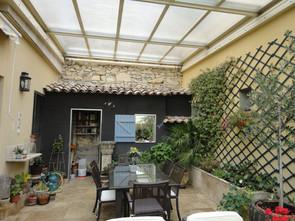veranda toiture coulissante jardin d'hiver