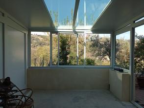 véranda toiture isolante avce puit de lumière.jpg