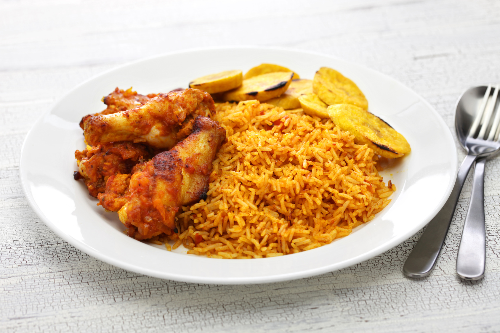 Jollof Rice, fried plantains,
