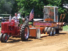 Farmall pulling the Nearpass sled