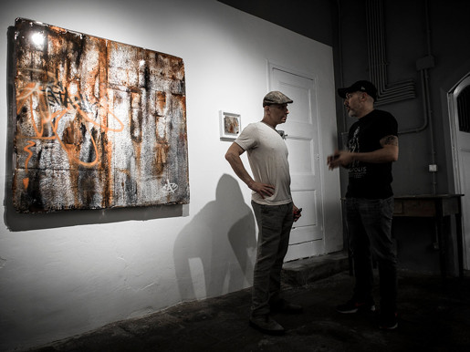 two people chat in front of an Ashwan resin work