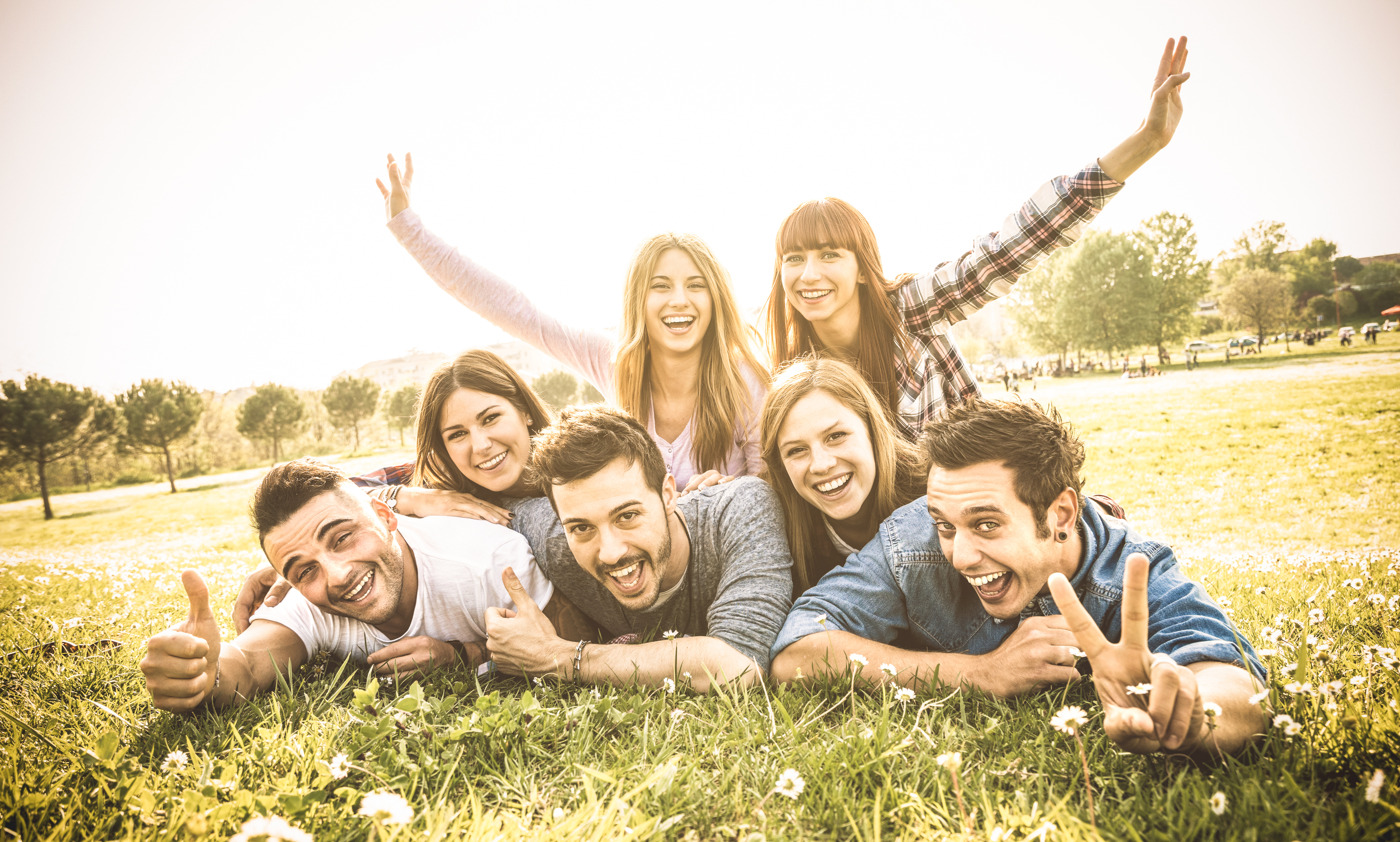 Friends group having fun together with self portrait on grass meadow - Friendship youth concept with