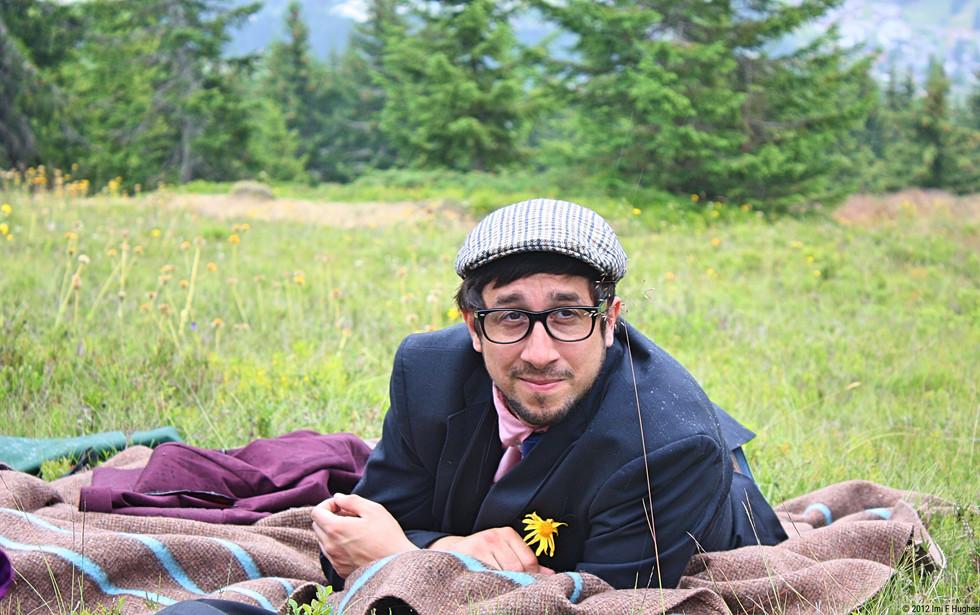 Man in flat cap on picnic rug.jpg
