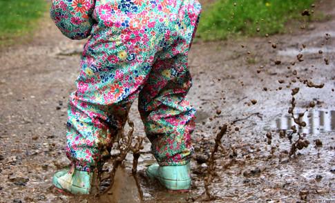 Child splashing puddle