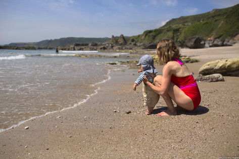 Mother and baby looking at the sea
