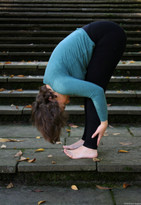 Yoga bending pose outside