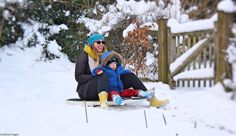 Mother and son sledging
