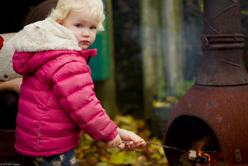 Girl toasting marshmallows.jpg