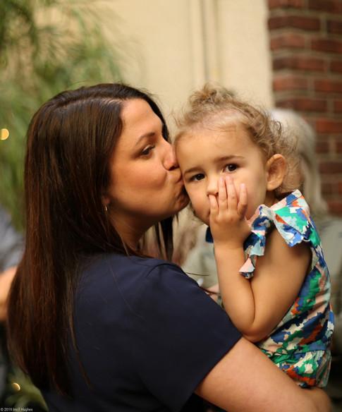 Aunt kissing niece
