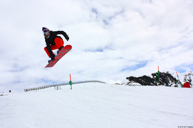 Snow boarder jumping