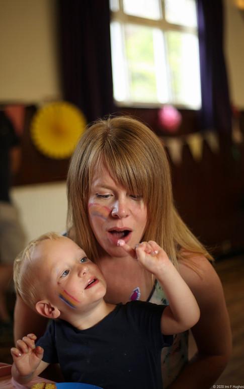 Child feeding mother