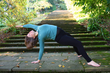 Yoga pose outside on steps