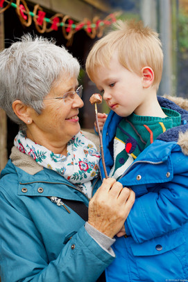 Grandmother and child with marshmallow.j