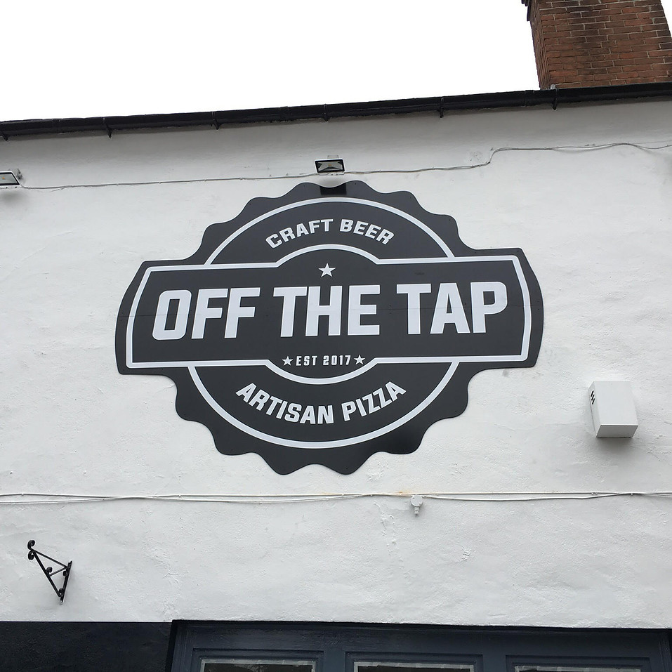 Off The Tap Signage on building wall