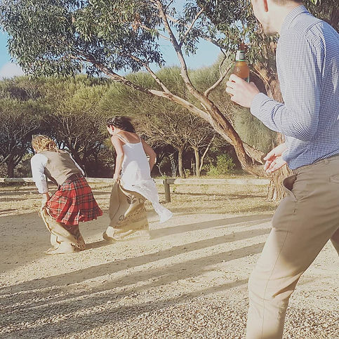 Potato sack race as part of the outdoor games at a wedding Tent Pegs Australia helped with event management