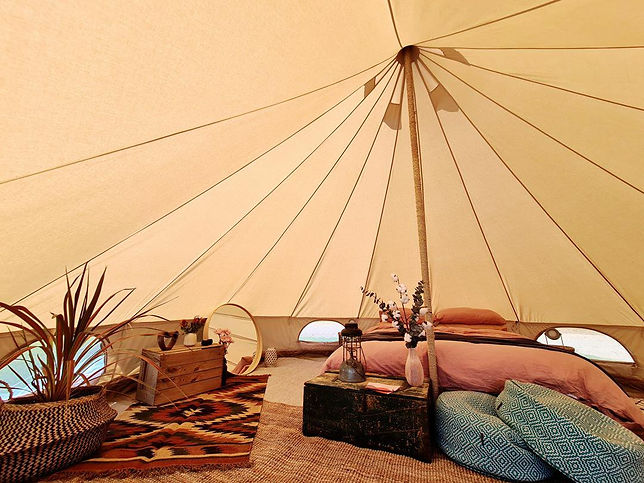 Bell Tent Interior with queen mattress and boho styled by Tent Pegs Australia