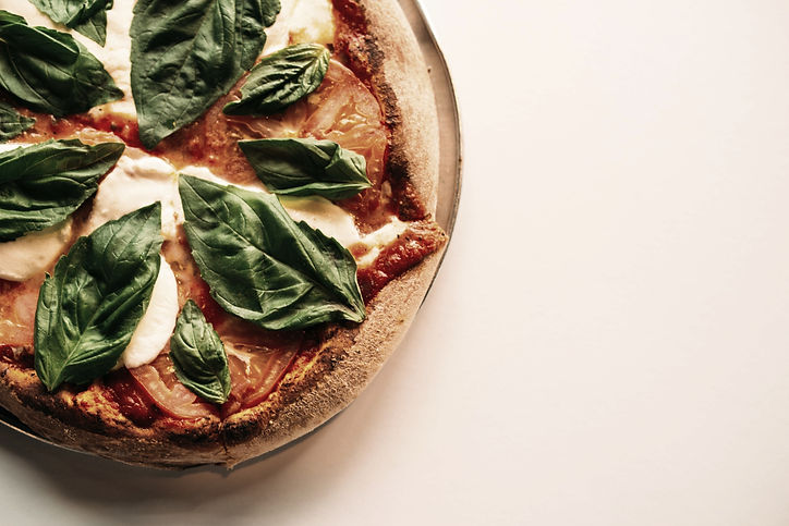 Homemade pizza cooked in a pizza oven in your glamping experience