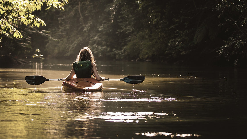 Girl kayaking down the river as part of the glamping experince with Tent Pegs Australia