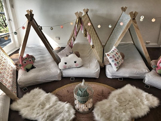 Sleepover party for kids. Our Tent Pegs Teepee package is ideal for the young kids, set up indoors at your house and consist in 5 teepees with mattresses, fitted sheets, blankets, pillows, cushions and decorations such bunting and fairy light between so much more, so your kids can be set off to dreamland after having the time of their life