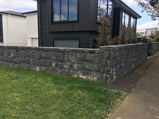 A bluestone wall that was repaired using stone and bluestone kerbing