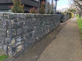 A double boundary stone wall that was repaired using stone and mortar