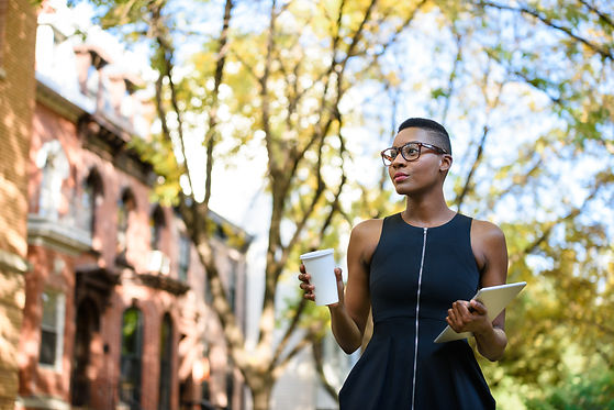 Young african business woman walking dow