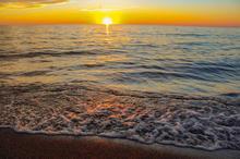 Suneset with waves edit.JPG