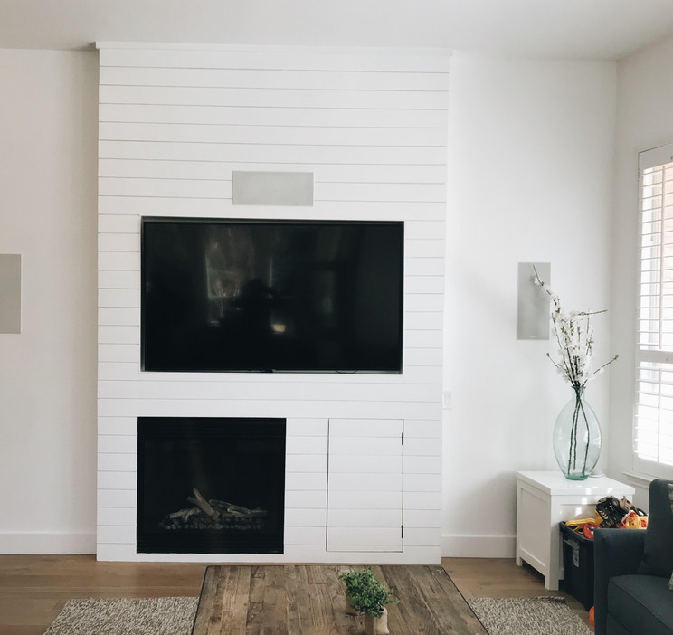 Shiplap fireplace with TV