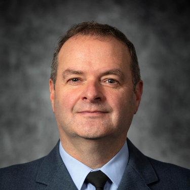 J B Crawford OBE