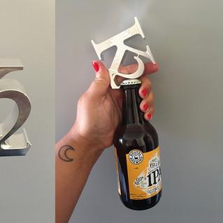 Logotype/Kapsylöppnare K2