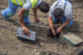 bigstock-Garden-Workers-Installing-Irri-