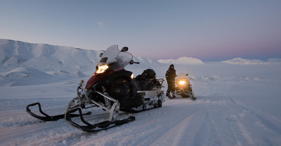 Snowmobiling at Sunset