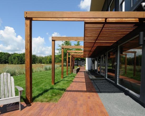 modern-garden-design-wooden-deck-gravel-path-pergola.jpg