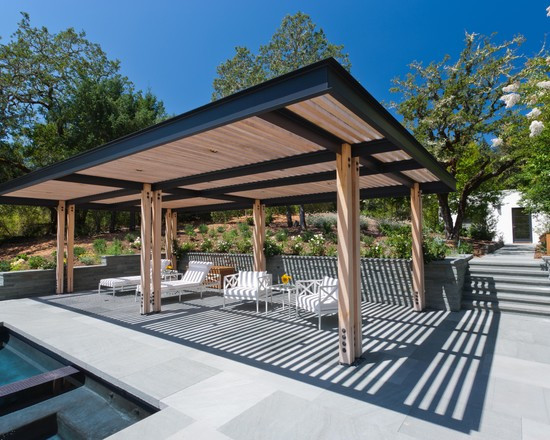 wonderful-sundeck-near-poll-of-modern-home-with-some-white-chaise-lounge-under-w