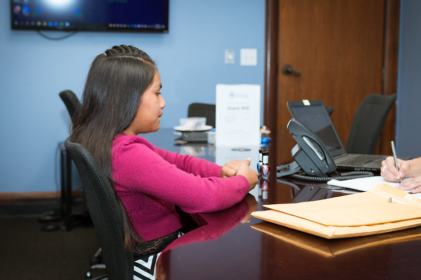Immigrant Defenders Law Center attorney works with a young client.